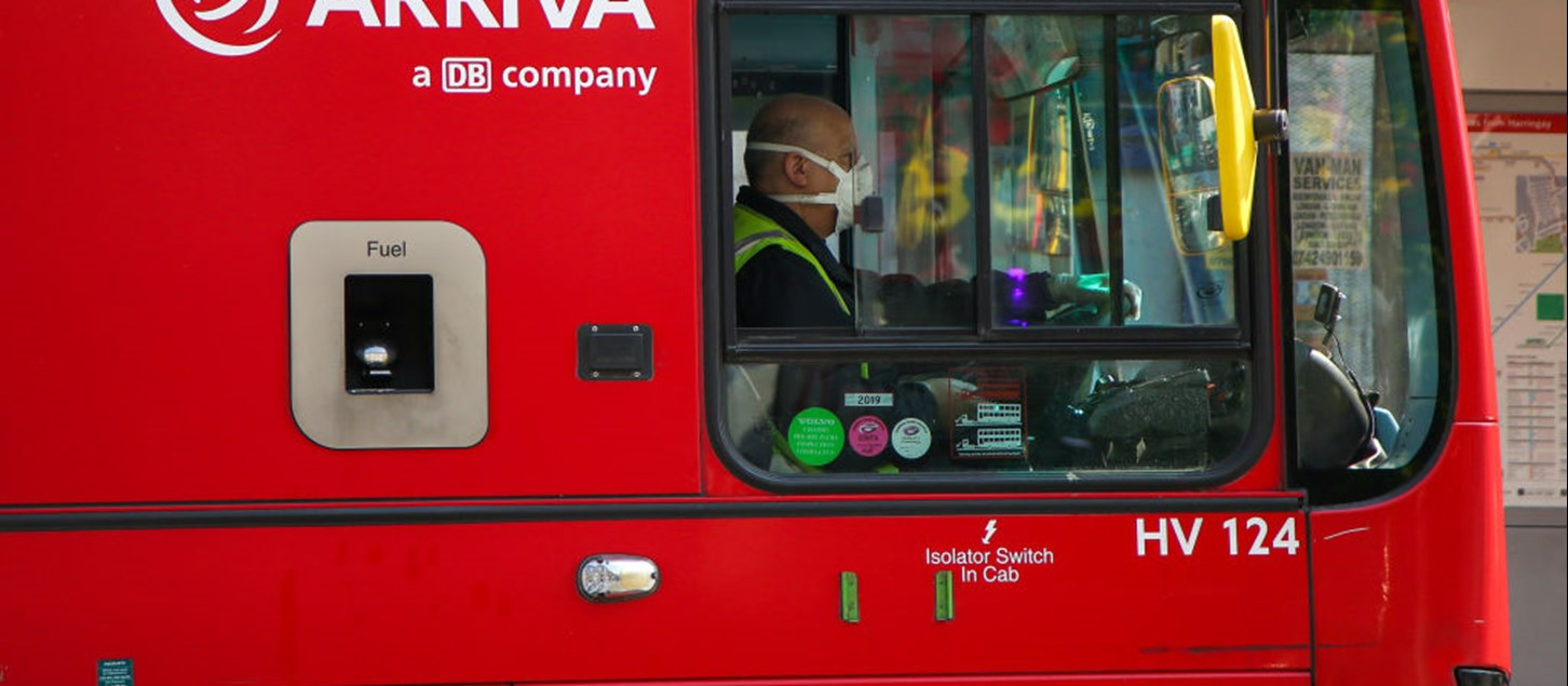 Bus driver with PPE mask